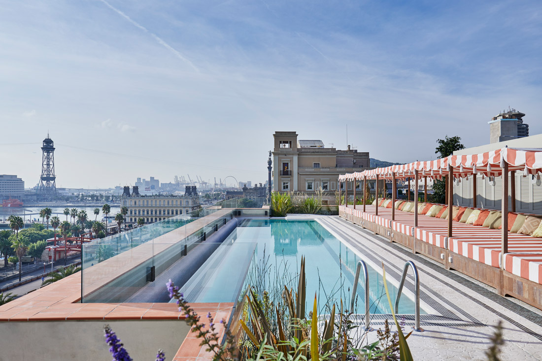 Rooftop pool with views across Port Vell